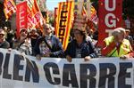 1 de maig a Girona Els secretaris generals de CCOO i la UGT a les comarques gironines, Bartomeu Compte i Dolors Bassa, a la pancarta que encapçalava la manifestació