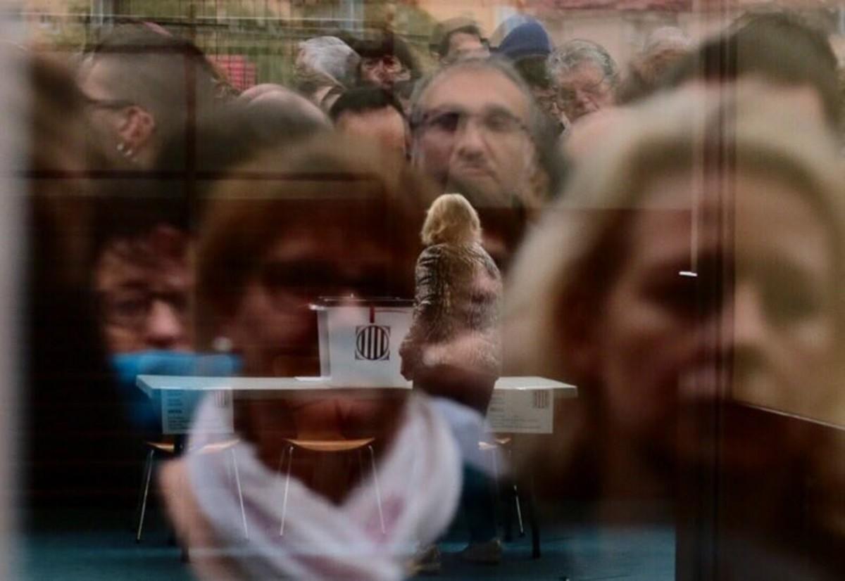 Les millors fotos de l'any de NacióDigital La participació definitiva en el referèndum s'enfila fins als 2,28 milions.Foto: Sergi Cámara