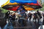Fira per la Terra 2011 Un tiovivo que funciona amb la força d'uns pedals.