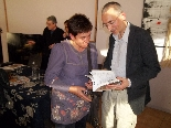 Presentació llibre Cuina catalana i tradicional L'editor Narcís Clotet comentant el llibre amb una lectora